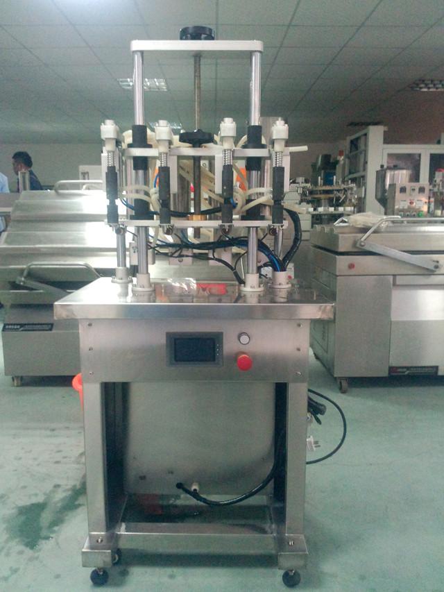 Close view of 4 heads semi automatic filling machine