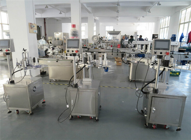 Factory view of flat surface top labelling machines