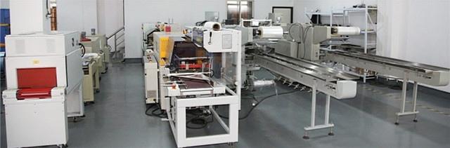 Show room view of PE, PVC, POF film L-bar heat sealing shrink packaging machine
