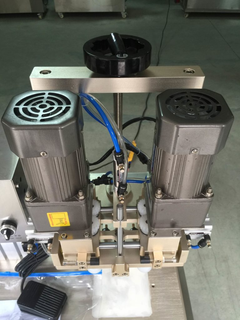 Up and down adjustment of capping machine