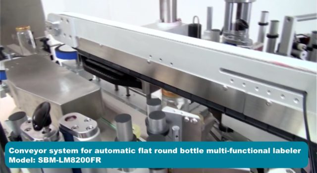 Conveyor system for automatic flat round bottle multi-functional labeler