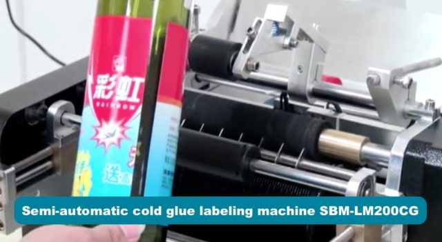 Semi-automatic cold glue labeling machine for round bottles