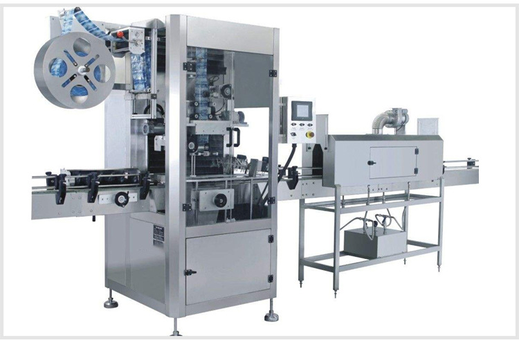 Shrink sleeve labeling machine with steam shrink tunnel