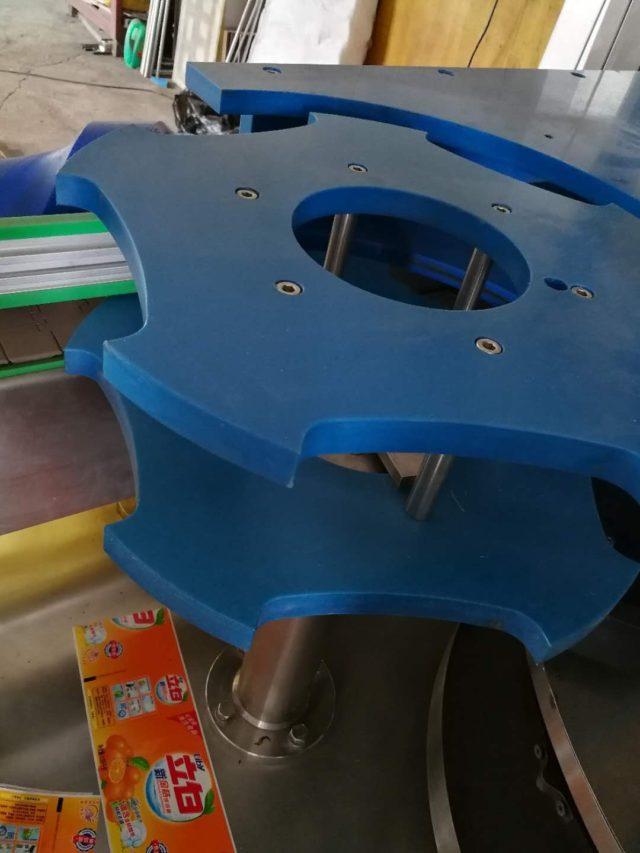 Bottle Feeding Star Wheel Device of automatic linear hot melt glue labeler model SBM-HMGL400