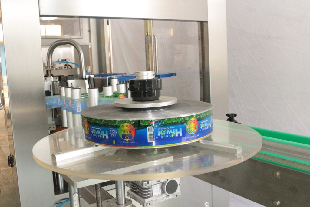 Film roll system of hot melt glue labeler