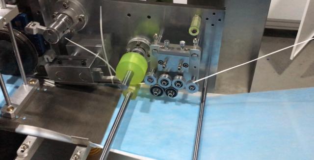 close-up of the mask making machine