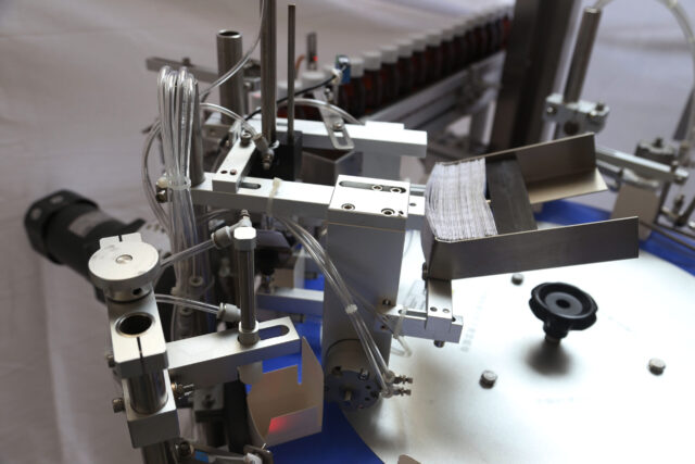 leaflet inserting system of the vertical rotary cartoner